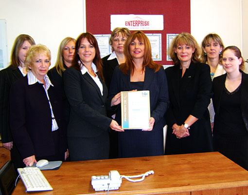 The whole EPL team with Marcia Roberts receiving the REC audited Certificate